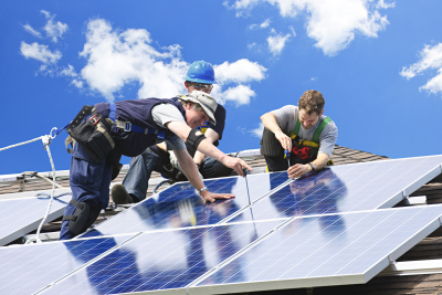 group of technician are repairing the solar panel