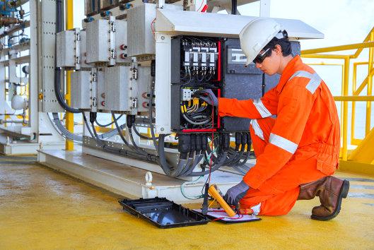 man repairing a engine